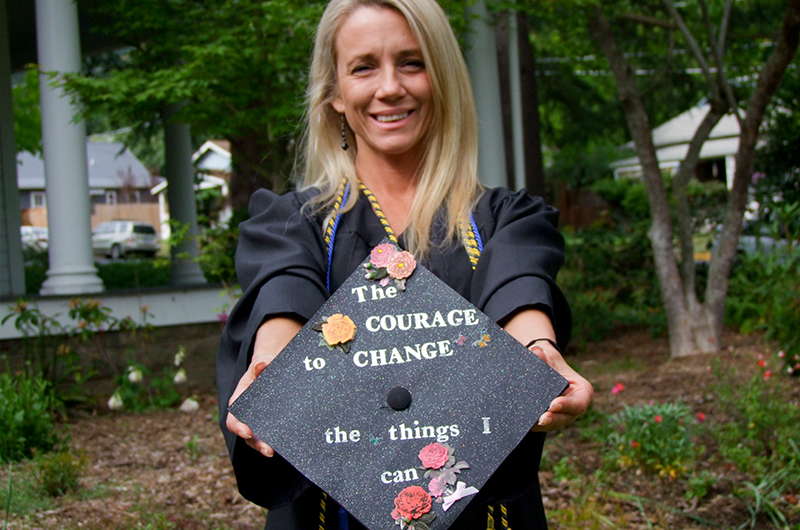 Grad holding courage cap