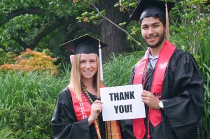 Two scholarship recipients with Thank you