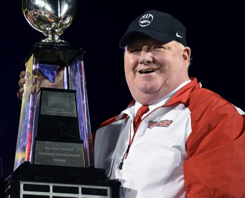 Coach holding national trophey
